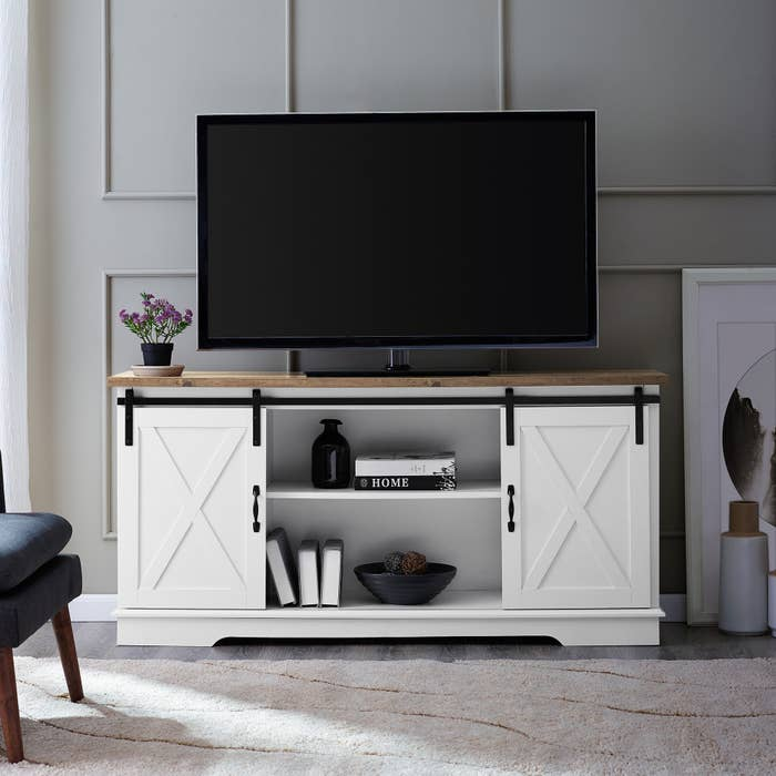 The white TV stand with a TV on top
