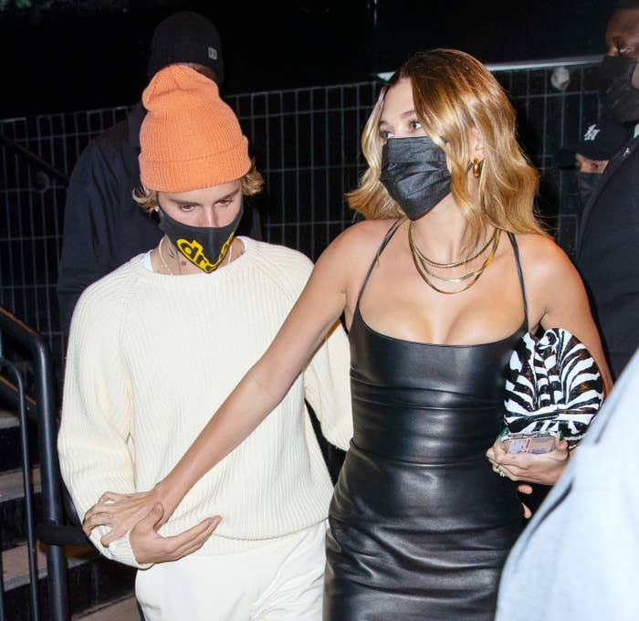 Justin Bieber hold hands with Hailey Bieber as they depart an SNL afterparty