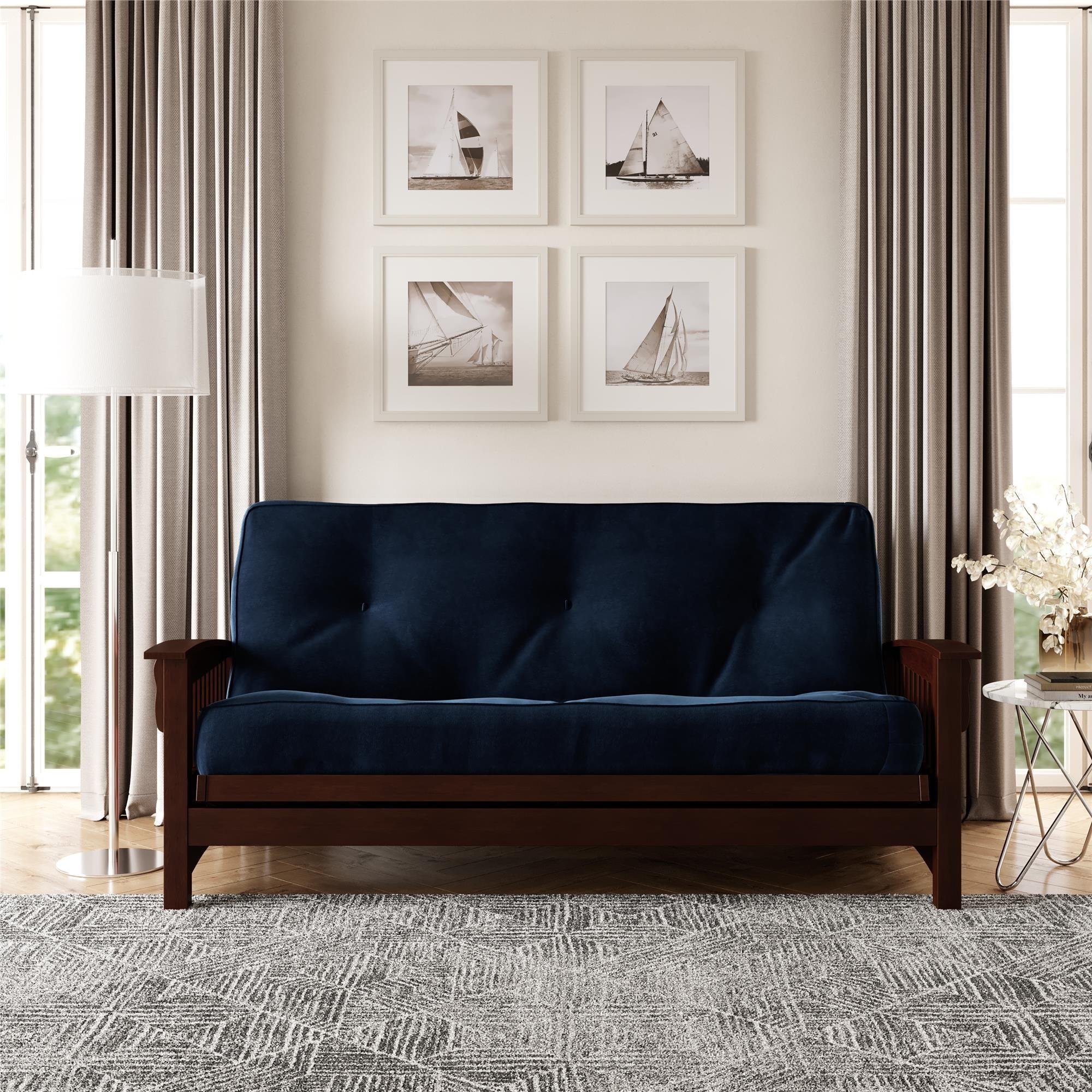 The blue futon under a set of photos