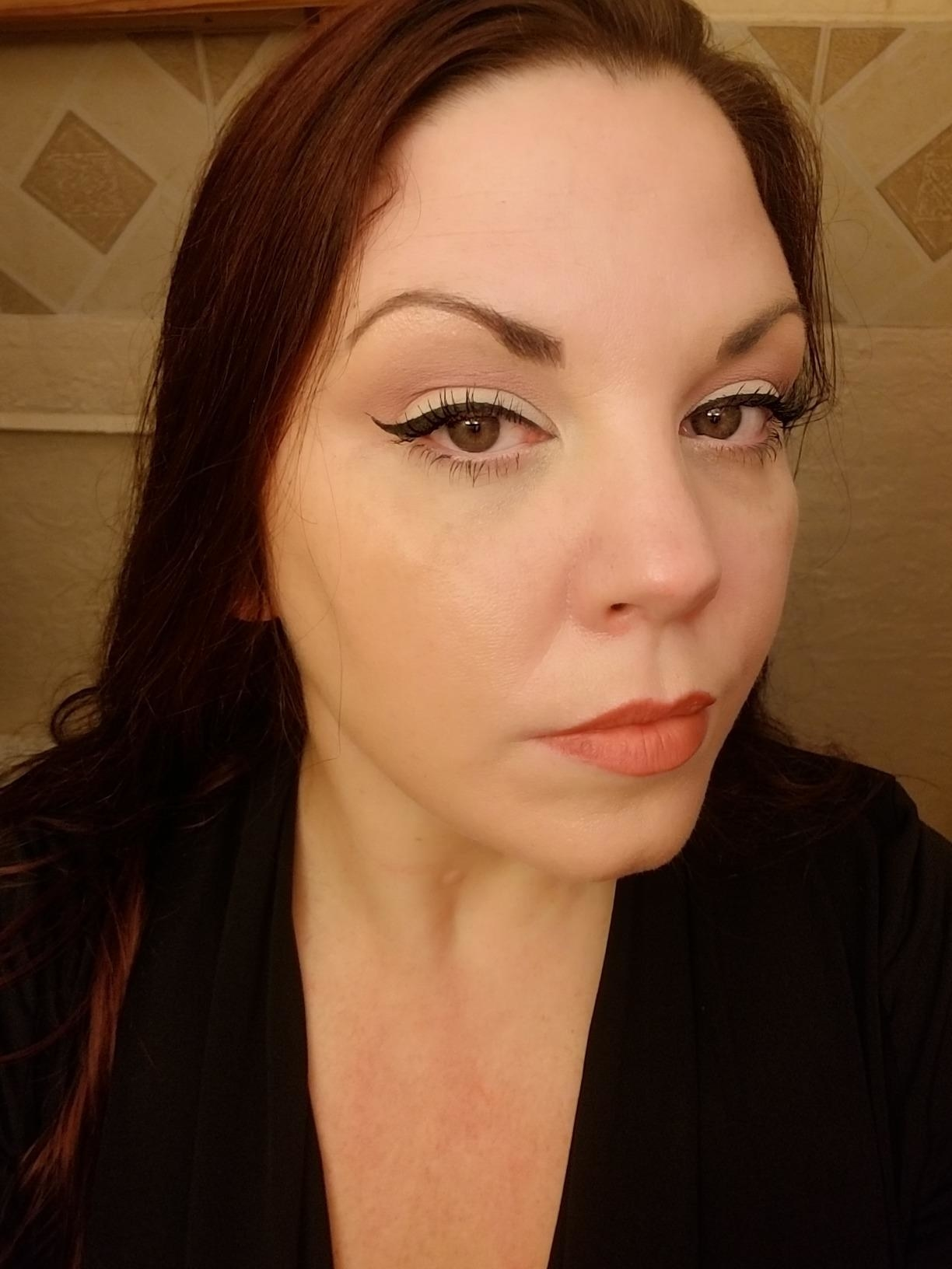 Reviewer showing off their perfectly drawn and super precise winged liner