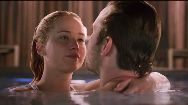 Lawrence and Pratt cuddle in a pool