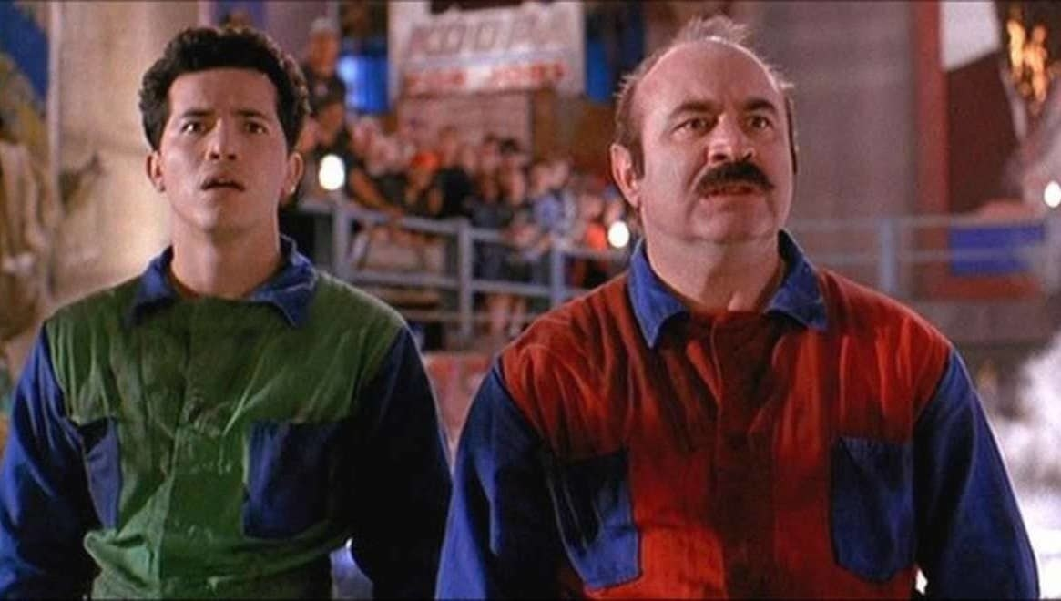 Hoskins and Leguizamo is colorful outfits as the Mario Bros