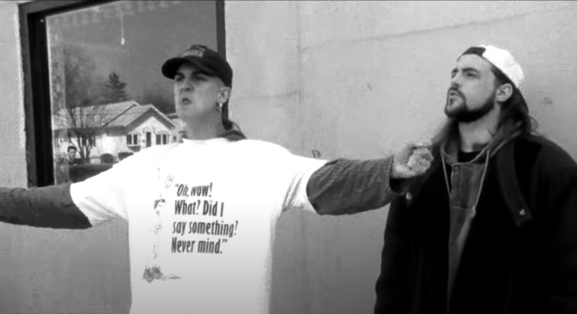 Mewes as Jay pontificates with hands outstretched in front of the mini mart