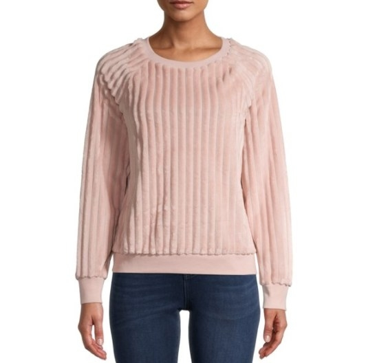 A pink, ribbed sweater