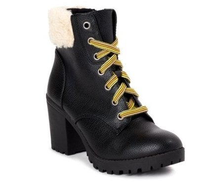 Black moto booties with yellow laces and fuzzy tops