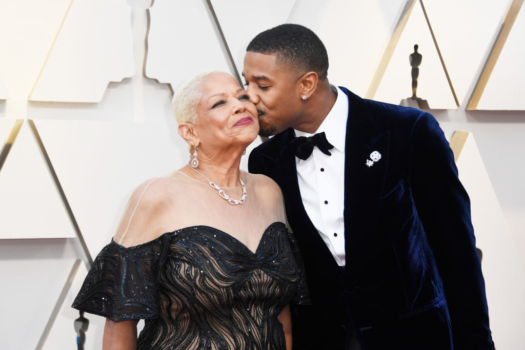 Michael kissing his mom on the cheek on the Oscars red carpet