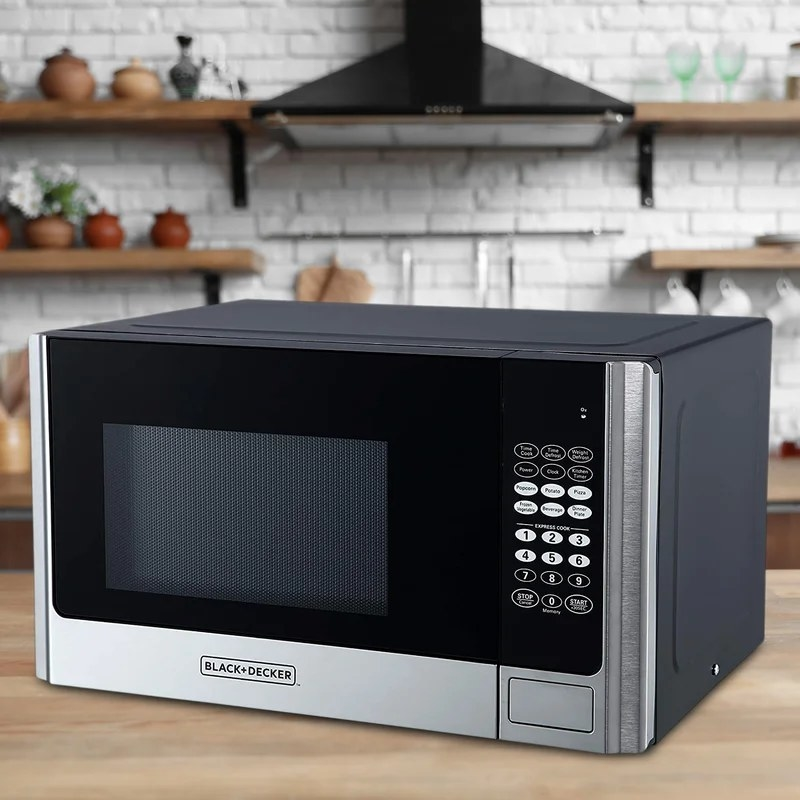 The microwave on a kitchen counter