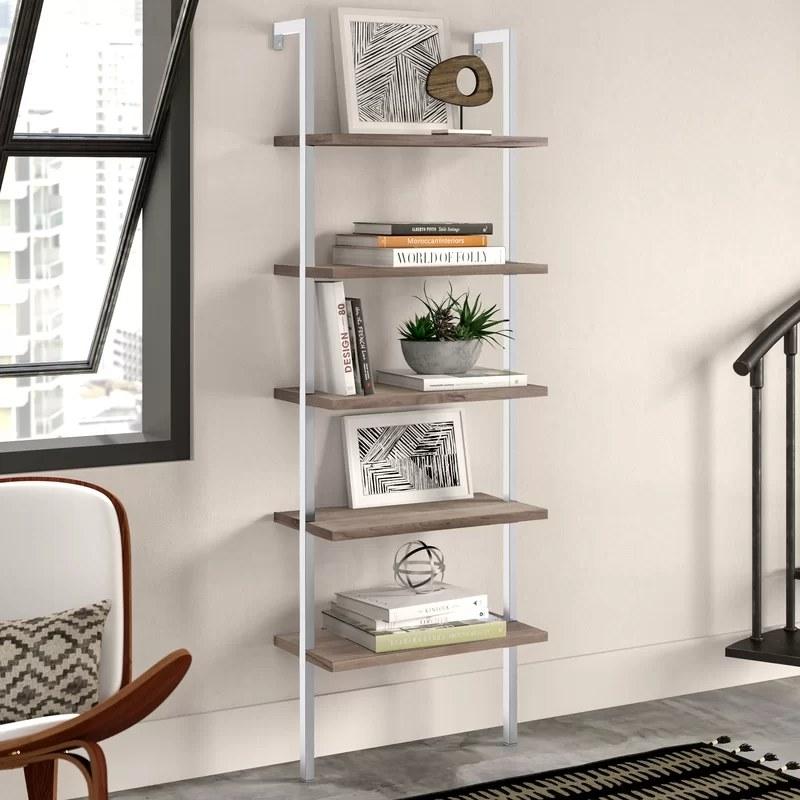 The bookshelf mounted to a wall