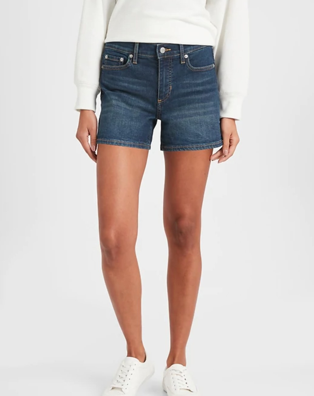 The pair of dark wash denim shorts in a 4 inch rise