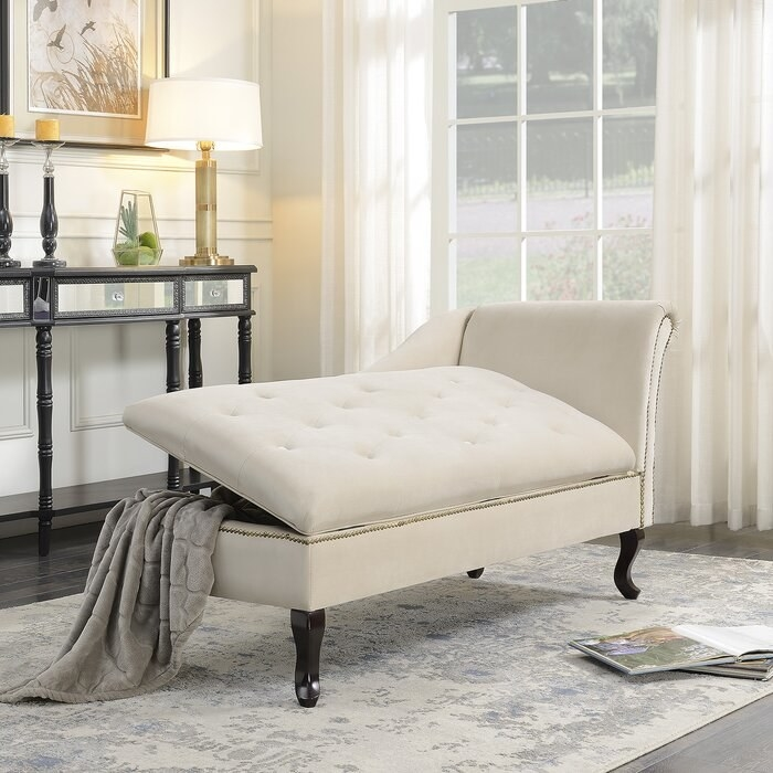 the beige house of kampton kroeker storage chaise slightly open in a decorated living room