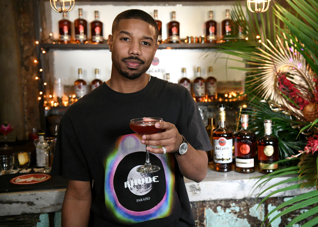 Michael holding a cocktail