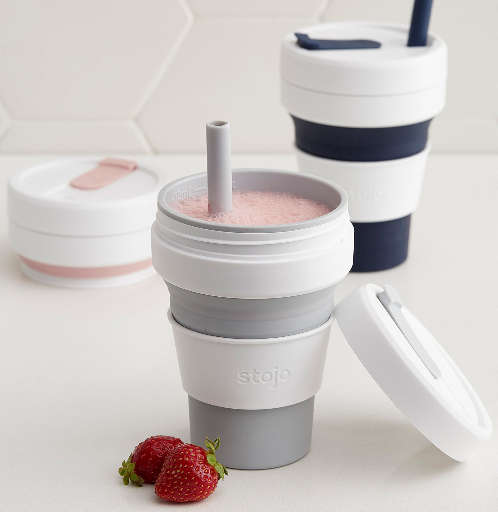 A silicone cup with a strawberry smoothie inside
