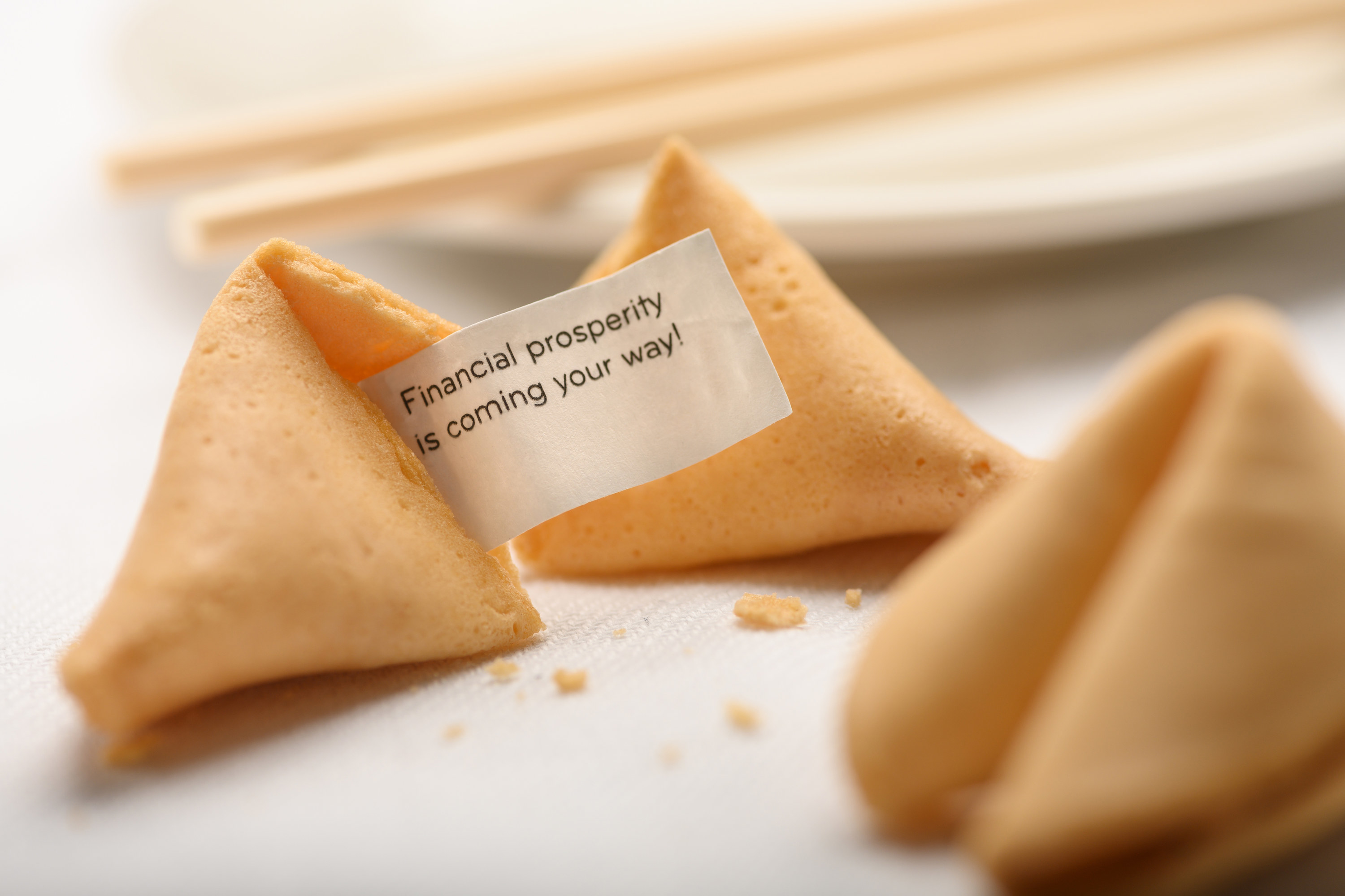 A broken fortune cookie with fortune visible