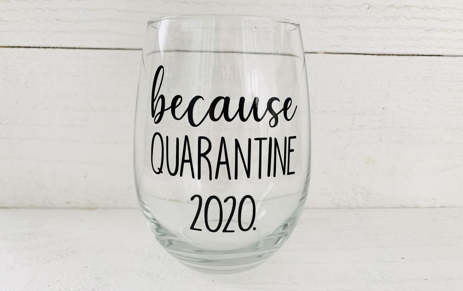 "The wine glass the reads ""because quarantine 2020"" in black text"