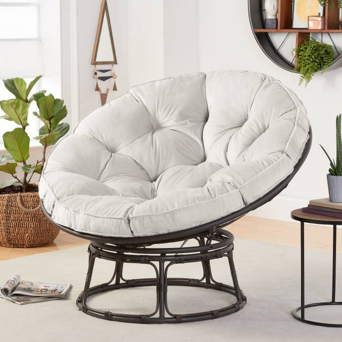 the cushion chair in gray displayed in a living room setting