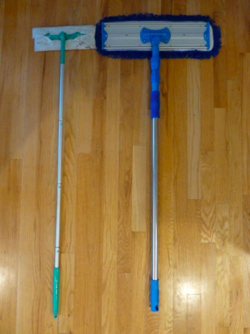 a reviewer's photo of the larger mop system on the right compared to a smaller mop from a different brand on the left