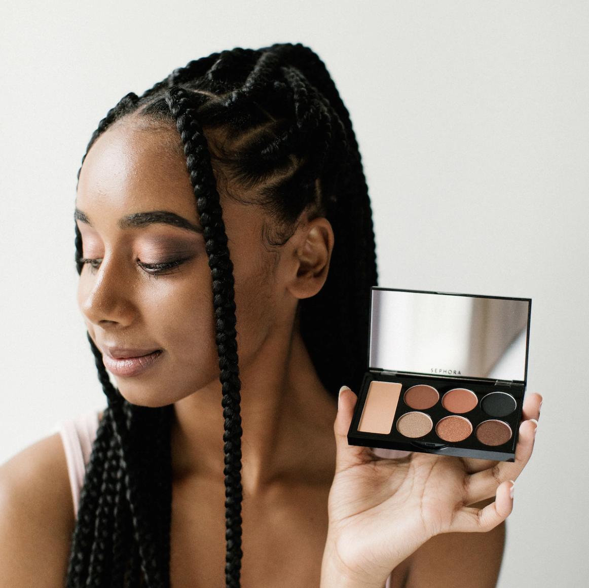 girl holding up eyeshadow palette