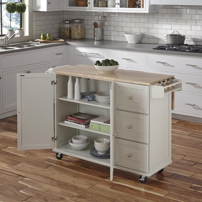 the off-white Kuhnhenn Kitchen Cart with Wood Top with open doors revealing three shelves