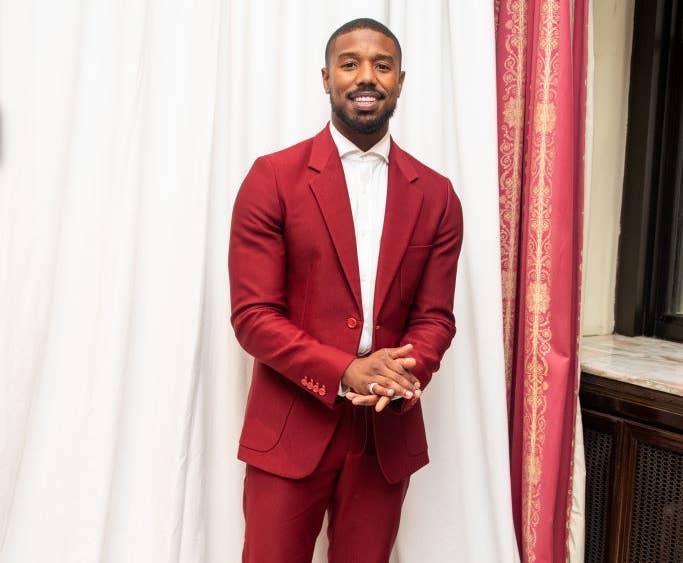 Michael B. Jordan wearing a red suit