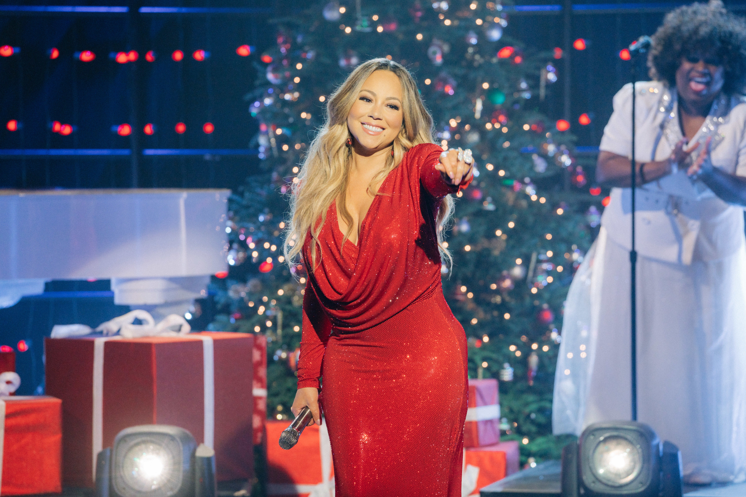 Mariah smiling and performing onstage