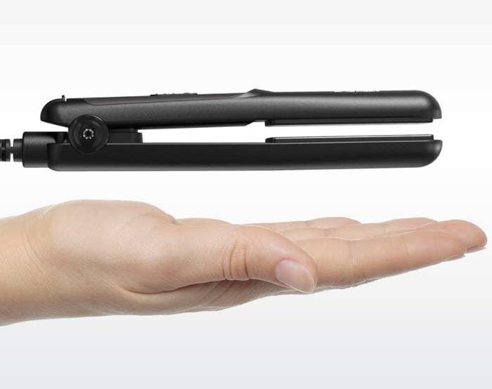 hand under straightener to compare size
