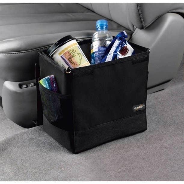 black waste basket made for the car