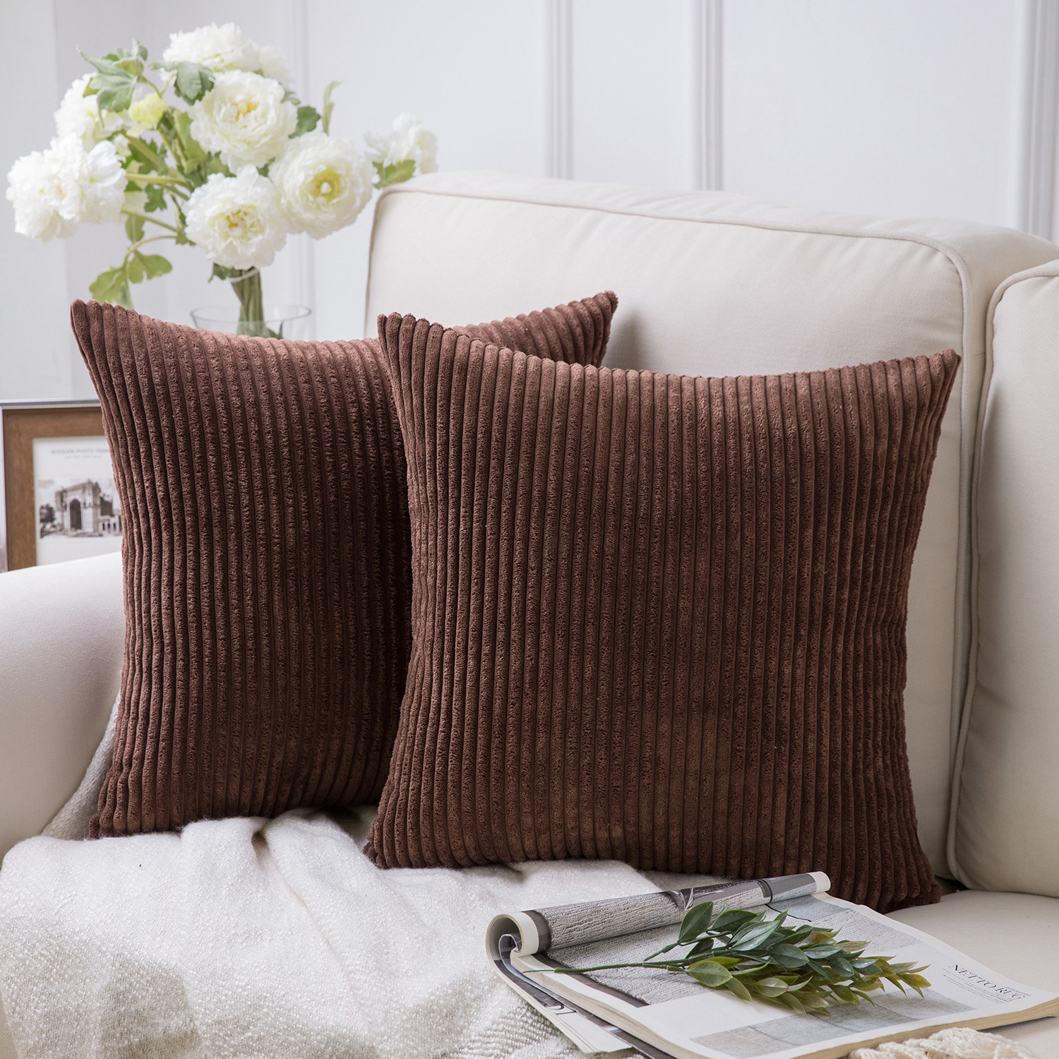 the pillow set in brown displayed on a couch