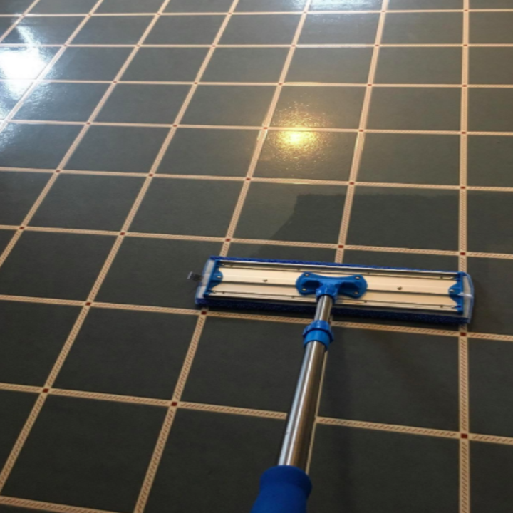 a reviewer's photo of the mop cleaning a tiled floor