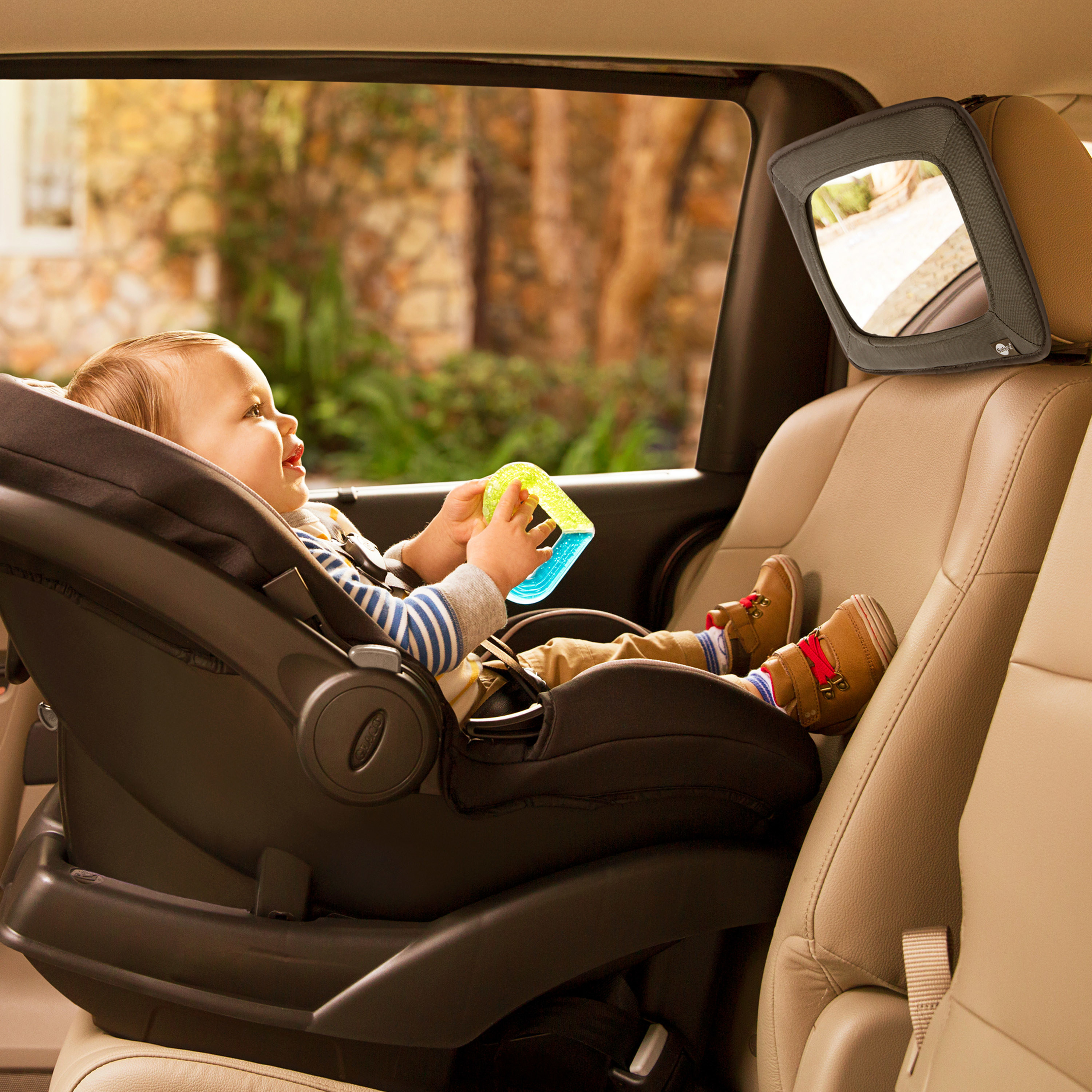 baby looking into a backseat baby car mirror