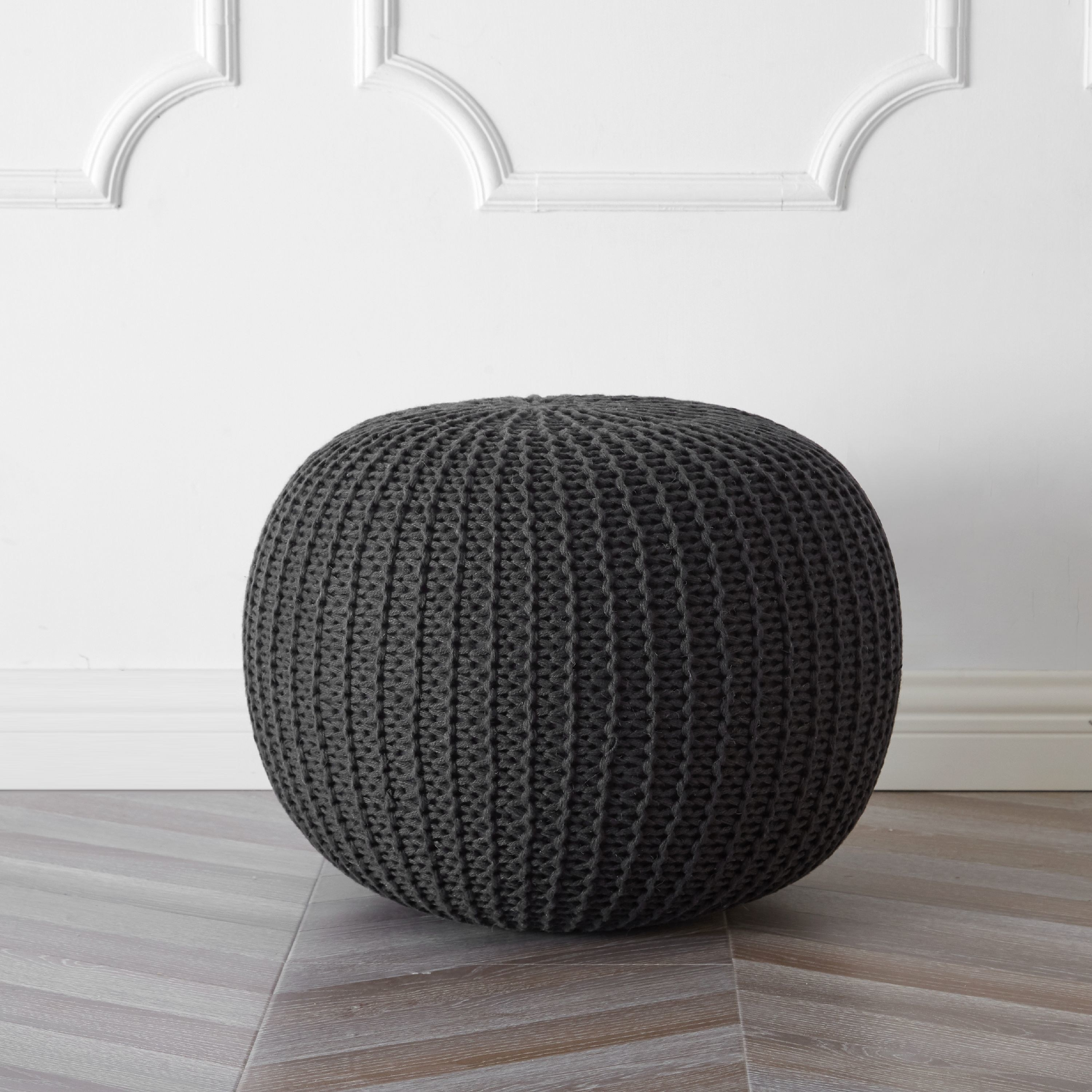 the round pouf in the color grey