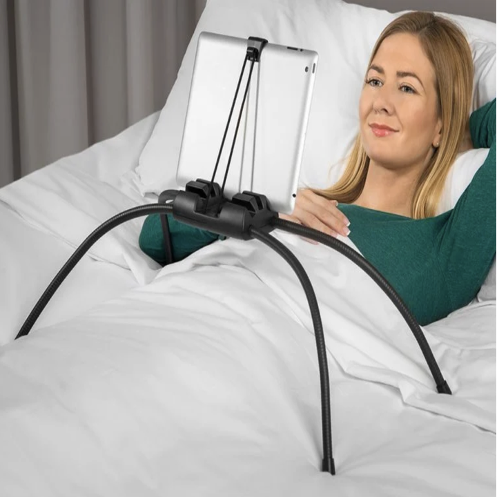 A model using it to watch television on a tablet in bed