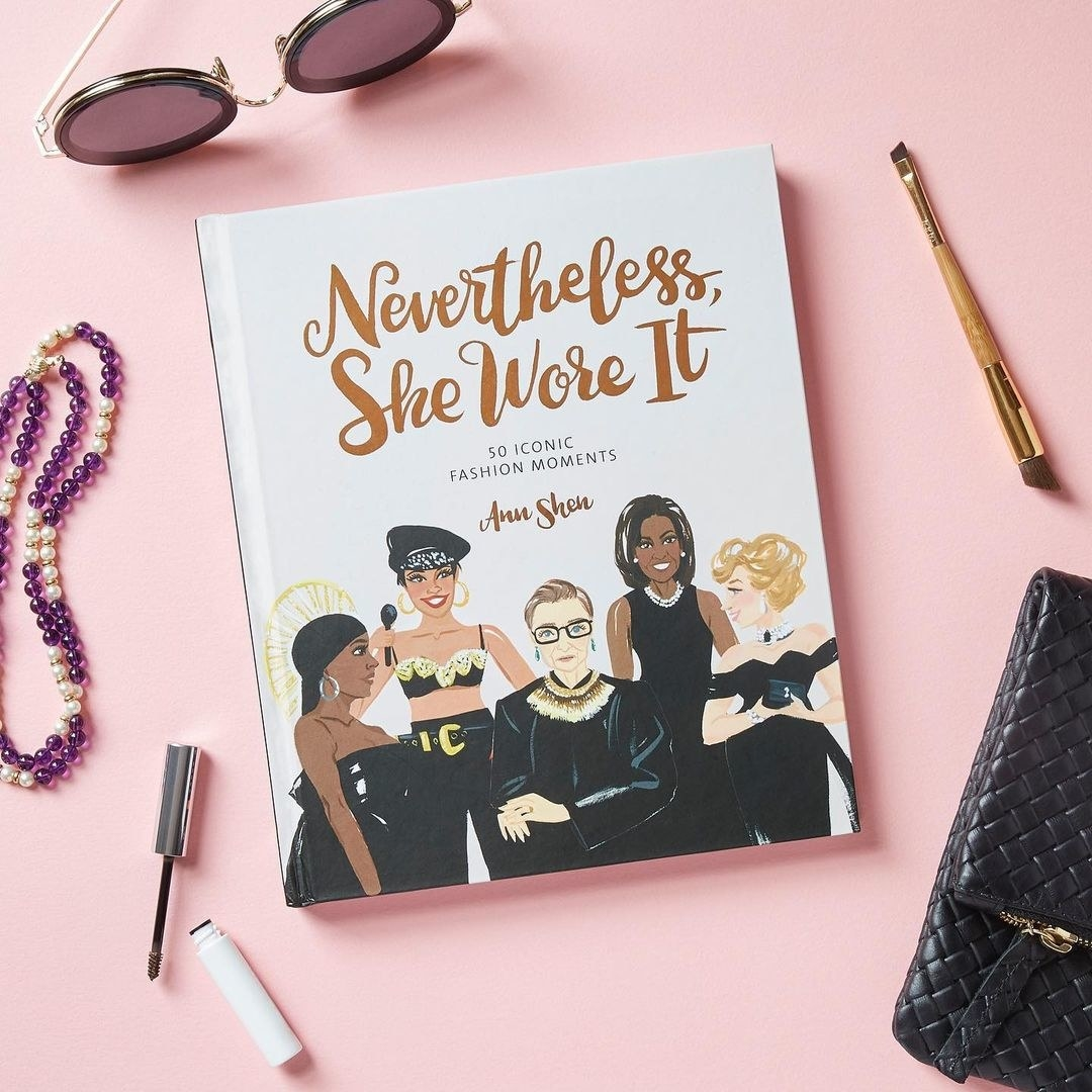 A copy of the book surrounded by beauty products and accessories