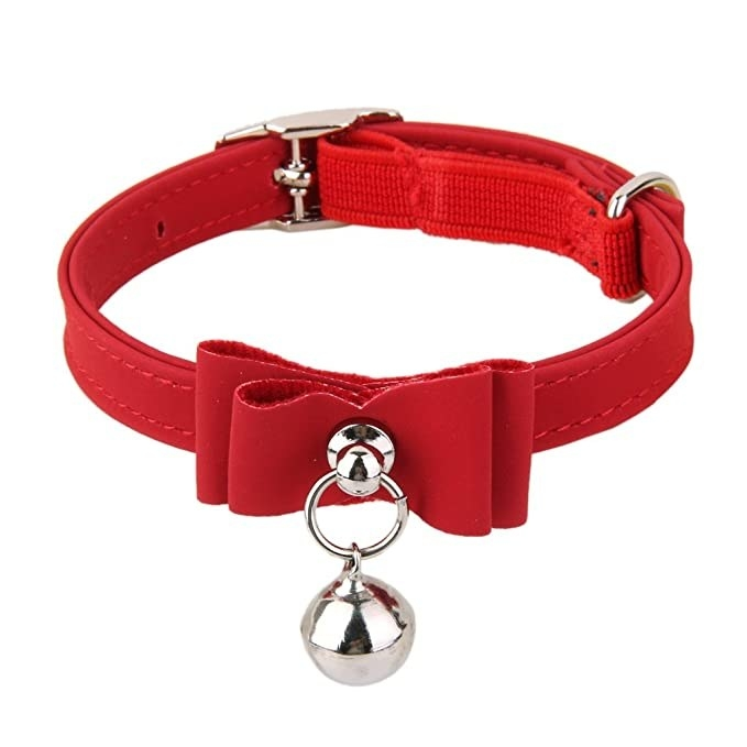 Red neck strap for cats with a bow and bell.