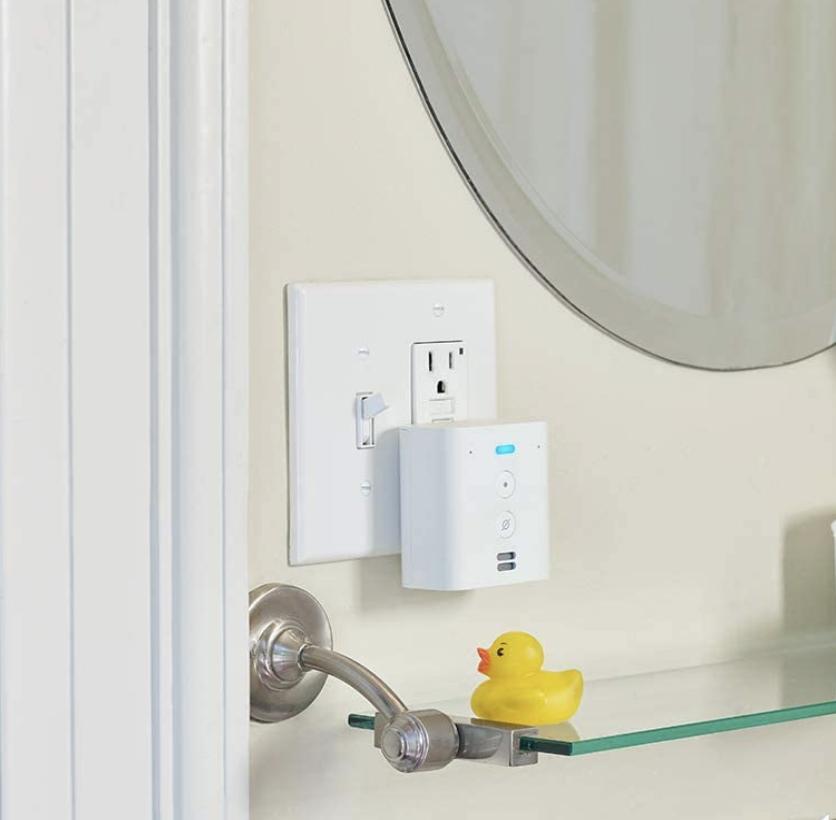 The Echo Flex plugged into a bathroom wall