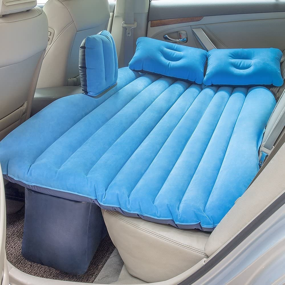 blue blow up air mattress in the back of a car