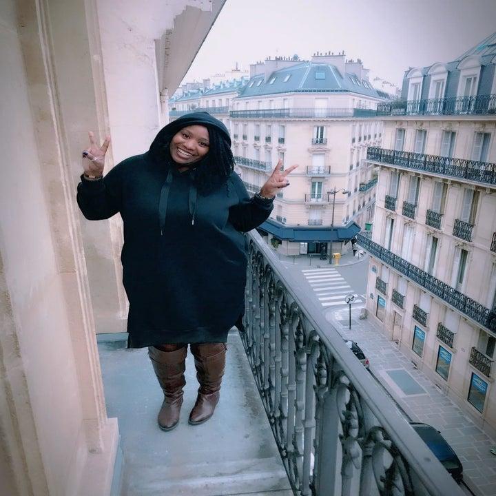 Reviewer wearing the knee-length hoodie dress in black