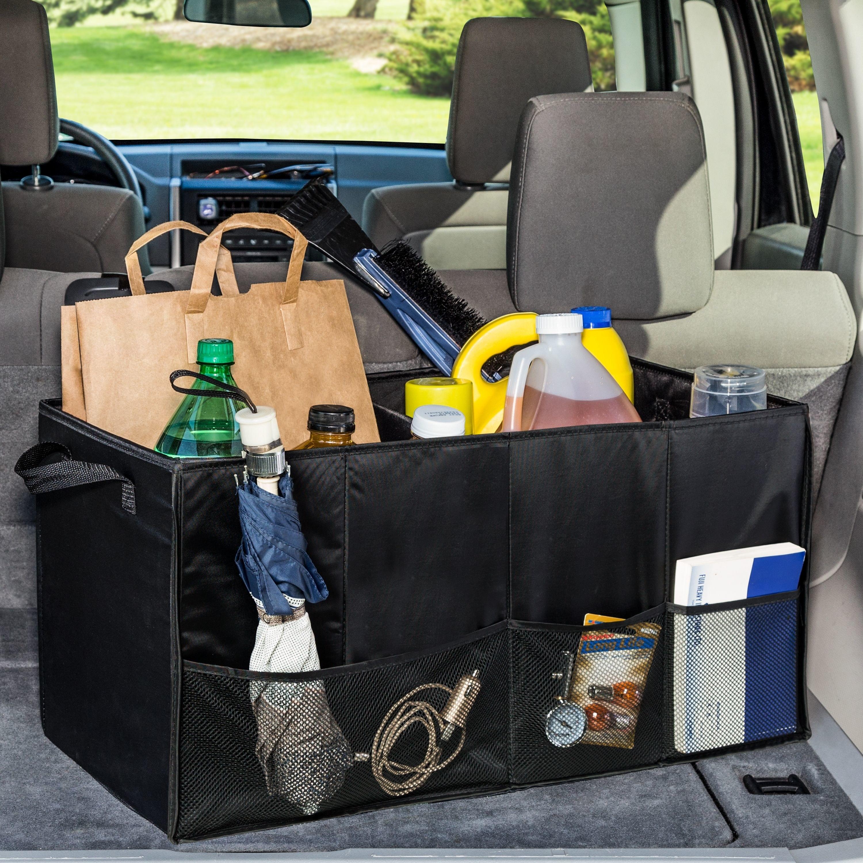 black car trunk organizer with groceries umbrella and random stuff in it