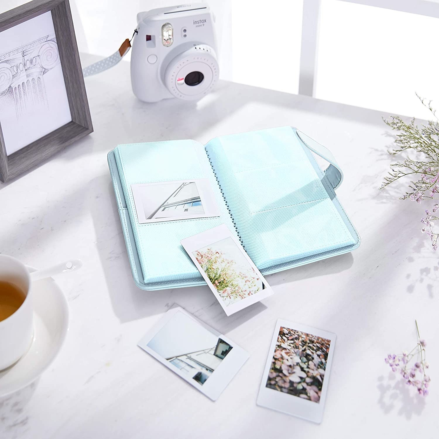 photo album surrounded by photos