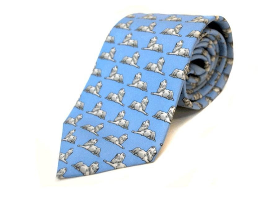 The blue tie with white stone lions in a repeat pattern