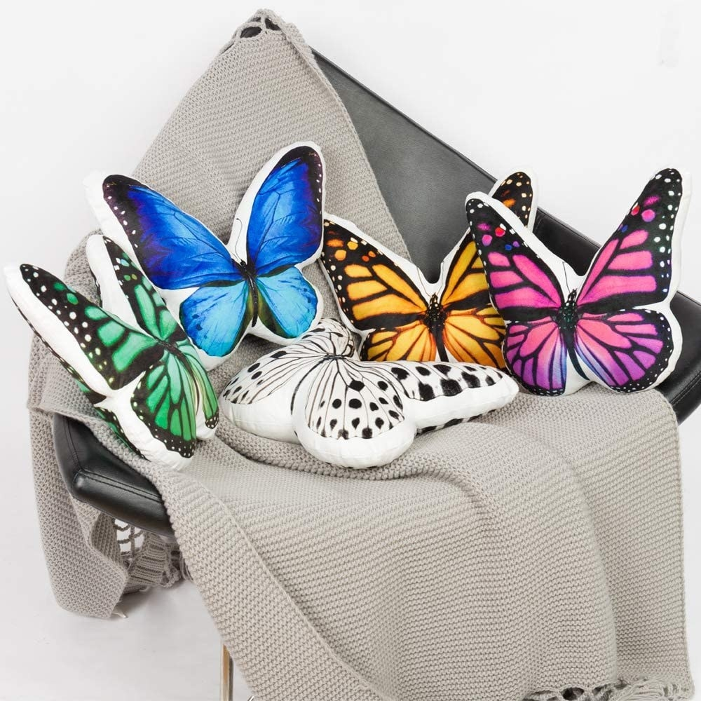 Five butterfly pillows in different colors