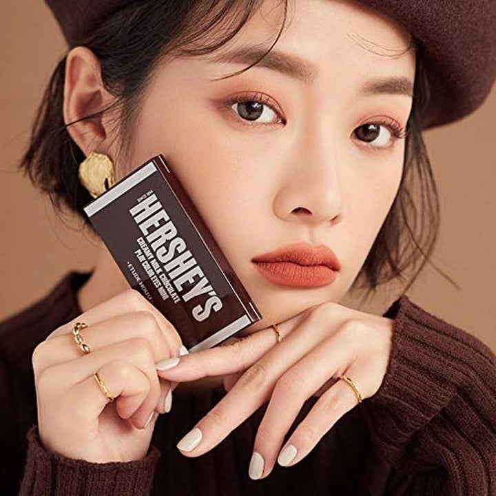 Person holding chocolate bar makeup
