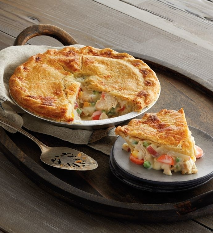 chicken pot pie with slice cut out of it on a plate