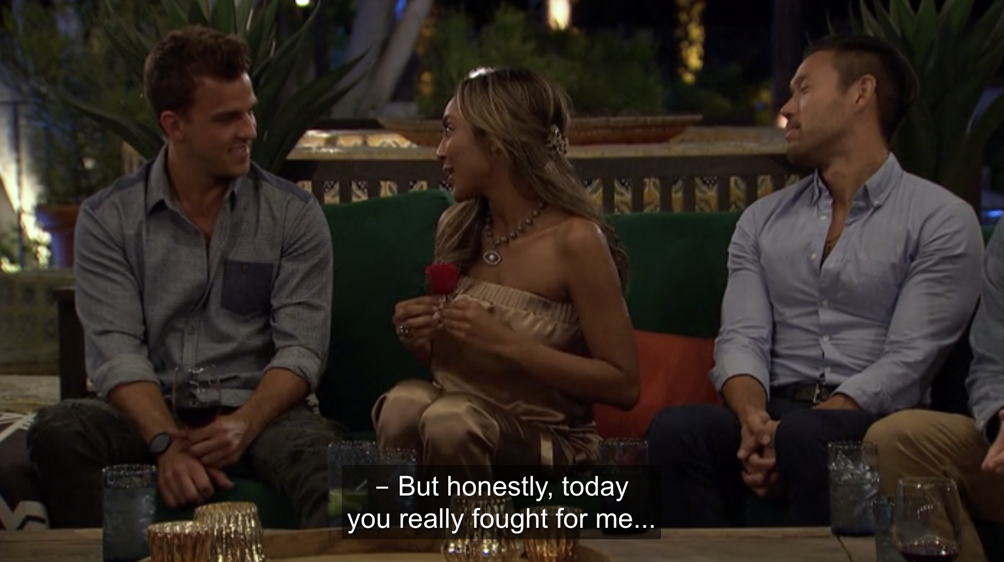 Tayshia presenting Noah with the date night rose