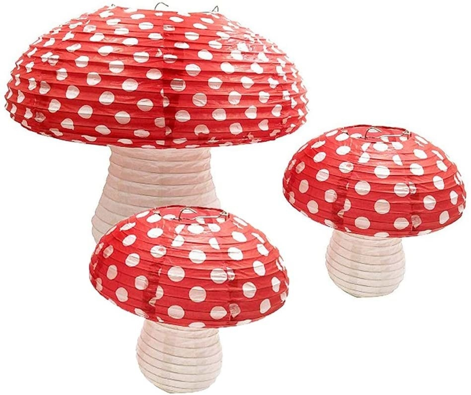 Three red top mushroom lanterns in different sizes