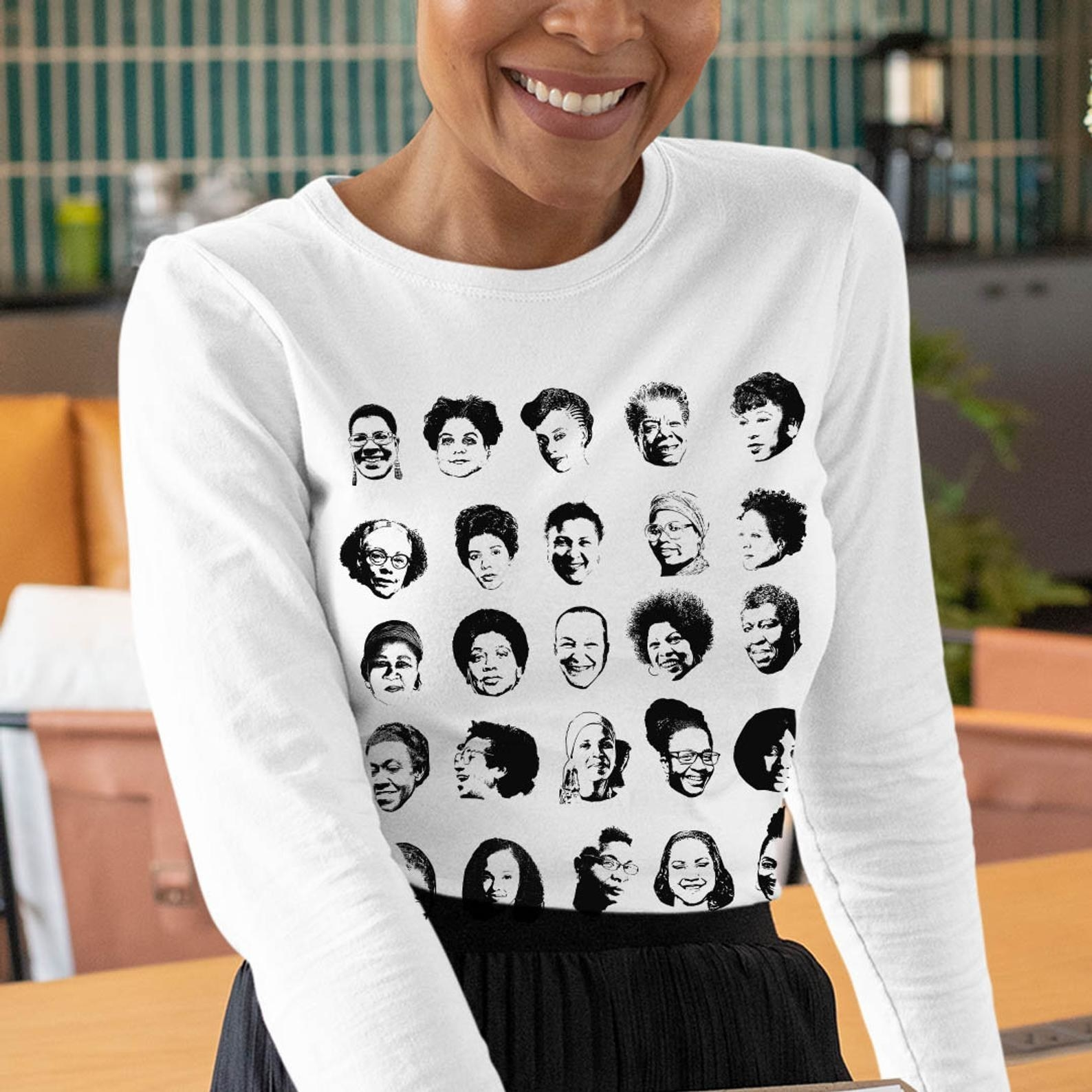 A model in the white long sleeve tee with 25 images of the authors' faces