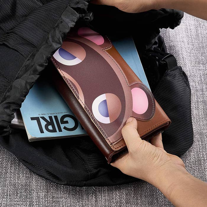 A person putting the case into their bag