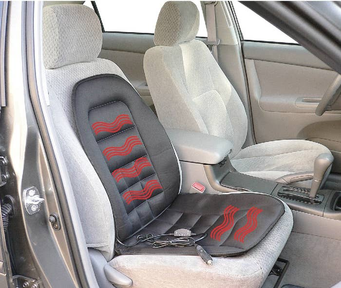 black heated seat cushion placed on a car seat