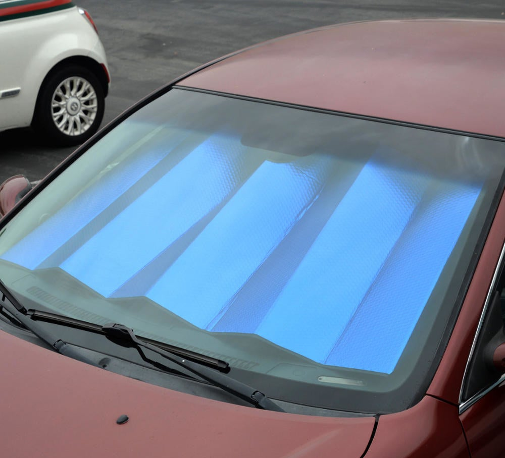 blue sunshade on the inside of a car