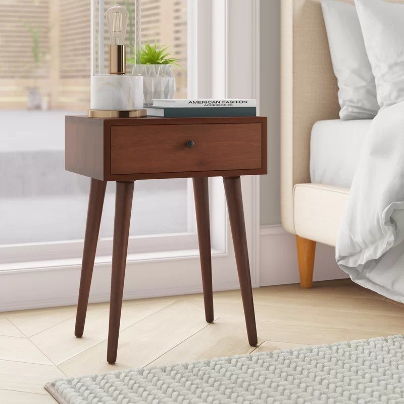 The table next to a bed