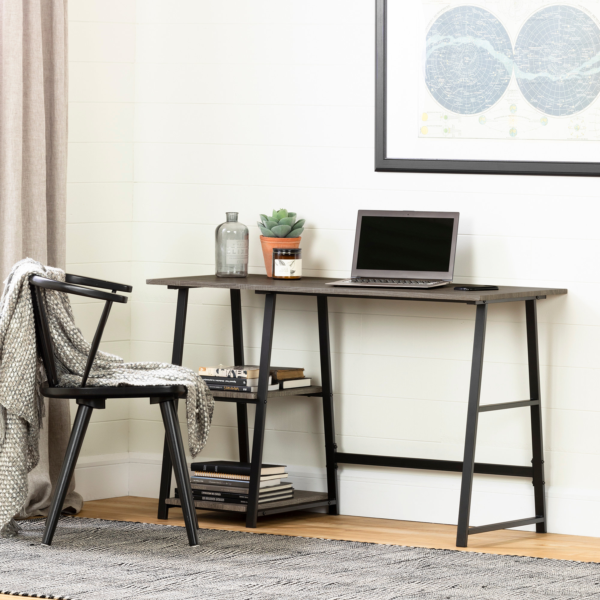 The black and wooden desk in an office setup